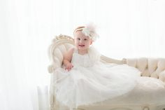 one year session! embroidered headband! White dress for little girl and elegant couch!