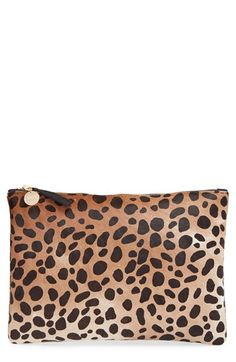 Free shipping and returns on Clare V. Genuine Calf Hair Leopard Print Zip Clutch at Nordstrom.com. This supple leather and calf hair clutch, with its wildly bold leopard print, takes your trend-savvy look to the next level in an instant. Impeccable craftsmanship informs this zip-style flat clutch, while gleaming hardware and Clare V.'s 14k gold-plated medallion make it distinctive. Clare Vivier's smart and functional bags are designed and crafted exclusively in the USA.