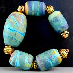 Lois A Brillinger poly clay BIG beads