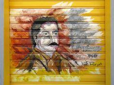 Chico Mendes on a shutter in Via Oberdan