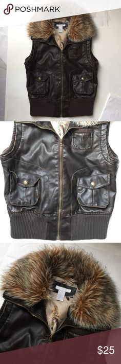 Brown Moto Vest with fur!!! Brown Faux leather with faux fur at the collar! So Chic! Two pockets in the front with zipper! Great condition! Vintage feel! 22 inches long. Chest measuring the front across 18.5 inches! Great condition! Charlotte Russe Jackets & Coats Vests