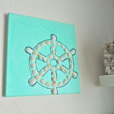 Ship Wheel Canvas 12x12 for $30.00. Wonderful nautical/coastal feeling to bring into your home. More over at jebeachgoods.etsy.com