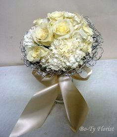 "Wedding Flowers - Brides bouquet of Hydrangea, roses and carnations surrounded by a wire and pearl ""nest""."