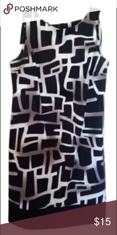 AB Studio patterned dress This dress has a fun pattern to make your day at work that much better! Black white with hints of grey make this dress great for any occasion! AB Studio Dresses