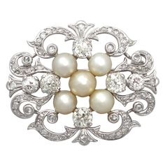 Victorian Pearl Diamond Gold Brooch | From a unique collection of vintage brooches at https://www.1stdibs.com/jewelry/brooches/brooches/