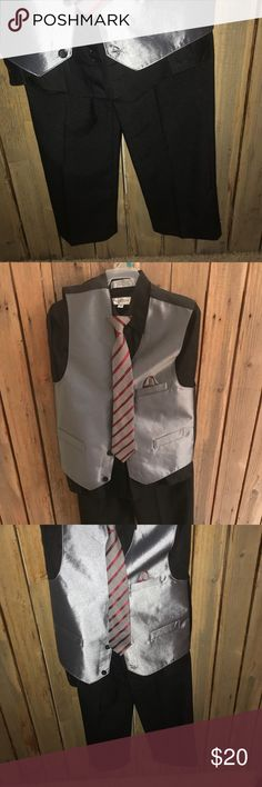 Boys suit Complete boys suit. The shirt is Van Heusen and suit is george.  Size 12 Matching Sets
