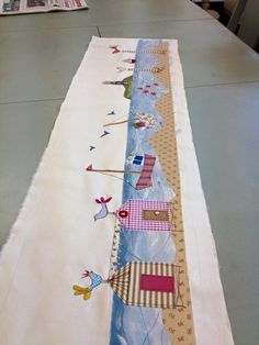 Applique seaside scene with machine embroidery ready to make into a lampshade
