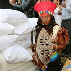 A Zulu bride being welcomed to her husbands home. (South Africa, KwaDlangezwe)