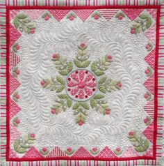 """Snowflake Medallion quilt, center, by Christabel.  The design is by Emma and Pam Jansen.  Custom quilting and photography by Quilts on Bastings (Australia).  She says: """"I have surrounded the centre applique design with a wreath of feathers and filled with my favourite background fill - pebbles."""""""