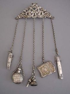 KERR  sterling 4 by 5chatelaine with 1-1/2 knife, 1-1/2 perfume, fob      and key, 1-1/3 match and 3-1/8 pencil.