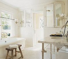 Benjamin Moore Ivory White (925) is the best warm white sans peachy/yellow tones per Lindsay Bierman of Southern Living
