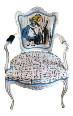 A louis chair is a gorgeous addition to any home and this Alice in wonderland inspired chair captures the whimsical essence of the book. Featuring Alice peering through a door and a gorgeous key print fabric on the base. The chair has been painted white then washed with an Alice