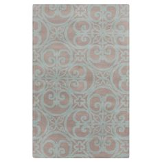 Add a pop of pattern to your living room or den with this lovely wool rug, showcasing an oversized scrolling medallion motif for eye-catching appeal.