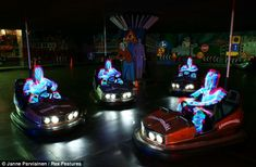 Bump in the night: Janne's skeletons have a go on the Dodgems - presumably after jumping off the Ghost Train