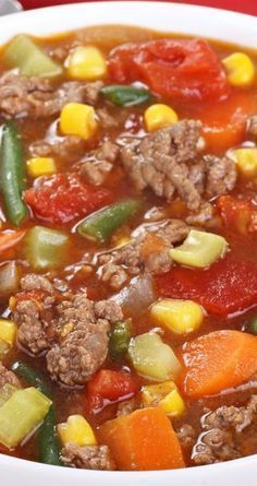Hamburger Vegetable Soup Recipe~ With ground beef, chicken broth, onion soup mix, tomato sauce, celery, onion, and frozen vegetables... Ready in just 30 minutes!
