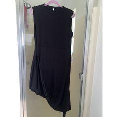Black asymmetrical dress Black asymmetrical dress size large never worn Dresses Asymmetrical