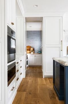 Hidden Kitchen Pantry Hidden Kitchen Pantry Ideas A custom pantry door opens to reveal a well-designed space Hidden Kitchen Pantry Hidden Kitchen Pantry Hidden Kitchen Pantry Hidden Kitchen Pantry Hidden Kitchen Pantry Kitchen Post, Kitchen Doors, Kitchen Cabinets, Shaker Cabinets, Kitchen Pantry, Prep Kitchen, Warm Kitchen, Hidden Kitchen, Hidden Pantry