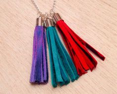 summer is coming, get bright and get noticed in gorgeous leather tassel necklace by myclectic on Etsy, donating 50% of the sale price to Make For Good. Leather Tassel necklace makeforgood aqua red purple by myclectic