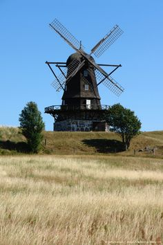 A landscape with an old windmill in Molle, Skane, Sweden.