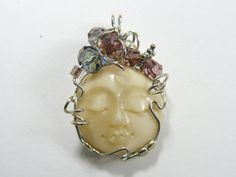 Carved Moon Face Wire Wrapped Pendant using by DesignsbyShirl