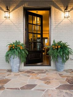 Two+frost-proof+textured+stone+planters+with+drainage+holes+flank+the+front+door,+adding+color+and+texture+to+the+porch+and+making+the+entry+stand+out.