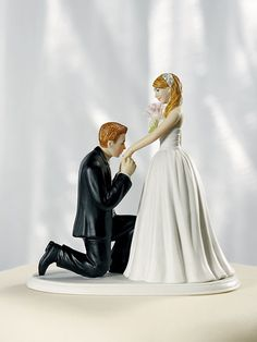 groom bride wedding cake top reception honeymoon gown Caucasian white ornaments holding hands embracing