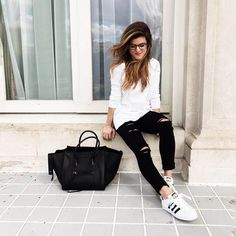 black ripped jeans Adidas sneakers