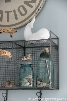 I love all of these beachy accessories - the shells, coral and blue mason jars eclecticallyvintage.com