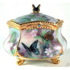Hights Of Fancy, a premier issue in the Lena Liu's Enchanted Wings. Heirloom Porcelain  Music Box Collection. Music selection is, Wind Beneath My Wings. Copyrighted in 2001. Item Number is AZ7285.