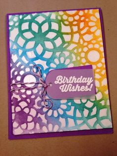 Birthday card with stenciled background and Distress Inks