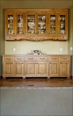 Rift Sawn White Oak Inset Cabintery    The feet at the bottom of the base cabinet are hand carved lions feet.    At the bottom of the upper cabinets you will notice two drawers, one on the left and one on the right, those are candlestick drawers.