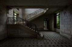 Stairs in an abandoned chateau in France, by Le Luxographe