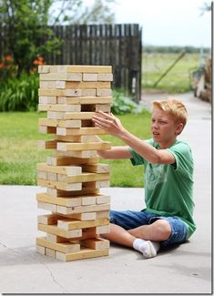 Make your own giant version of the game Jenga using 2 x 4's.  I once played huge jenga, where you had to stand on a ladder to play. It was fun. You should se if camp can build something like that. It's fun.
