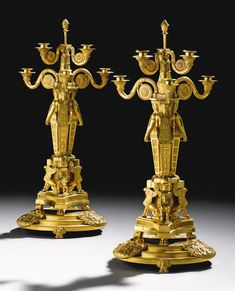 A pair of Regency gilt-bronze six-light candelabra and stands, almost certainly supplied by Alexis Decaix for Rundell, Bridge & Rundell, circa 1802 - 1806
