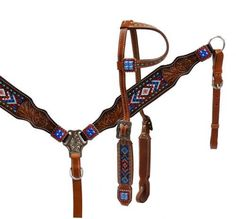 This set features medium oil leather accented with chocolate tooled leather on cheeks and breast collar. Tooled leather is accented with buck stitch design,blue and red stone conchos, giving it a patr