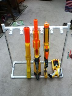 DIY Nerf Gun storage rack. PVC pipes. Only around $20 for the pipes and corners. Less than 1 hour to build! Will need to make another for the Nerf pistols.