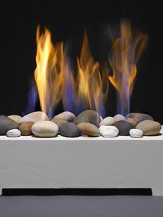A modern alternative to gas logs or traditional fireplace inserts, vented Gas Stones provide a sleek minimalist design perfect for any space. Traditional Fireplace, Gas Logs, Fireplace Inserts, European House, Minimalist Design, New Homes, Outdoor Decor, Stones, Home Decor