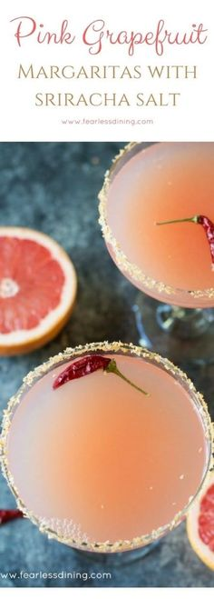 Easy fresh pink grapefruit margaritas with sriracha salt rim. How to make a margarita cocktail. Delicious happy hour libations.  via @fearlessdining