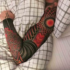 black and red man's tattoo sleeve
