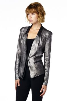 Cute glamorous jacket with snake skin patterns on the jacket. Featuring leather patch on the collar and back. ShopChicBella.com  Content: Shell A - 92% Polyester, 8% Spandex, Shell B - 50% PU, 50% Cotton, Shell C - 92% Polyester, 8% Spandex, Inside - 100% Polyester