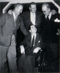 """The Wings of Eagles"" (1957) - Ward Bond, John Wayne & director John Ford with aircraft carrier pioneer Spig Wead (in wheelchair) upon who the film was based."