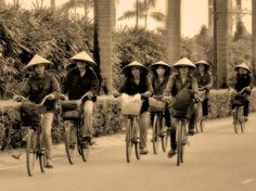 Cyclists by Marco Sarli www.emporiumhanoi.com #Hanoi #Vietnam #photo #photography #travel #holiday #tour #street scene