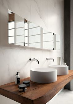 Marble bathroom with recycled timber vanity and white basin