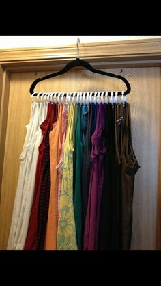 great space saving idea! Organizing tank tops. I am definitely doing this. My current system is not working. Yes, even a professional organizer's own organizing system needs to be revised!