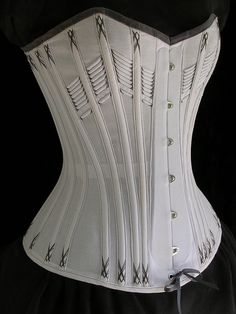 Summer corset made of cotton adia cloth. Cotton coutil bone casings, cotton cording at bust, cane boning, steel spoon busk, and cotton flossing. Late 1880's pattern by Norah Waugh from Corsets and Crinolines.  Gray and white...