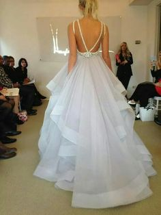 Hayley Paige: Dori gown; Alabaster tulle bridal gown with halter high neck alabaster and crystal bodice, full horse hair flounced skirt and chapel train