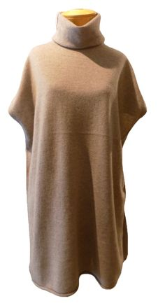 Eileen Fisher Undyed Cashmere Turtleneck Sleeveless Tunic - Almond: Hello, gorgeous! Eileen Fisher's amazing sleeveless cashmere tunic seriously wows us! Luxuriously soft this beautiful tunic drapes down the body and moves sensuously along with you. A beautiful almond-colored cashmere isn't dyed with harmful dyes, and is the perfectly sophisticated neutral to wear with everything!