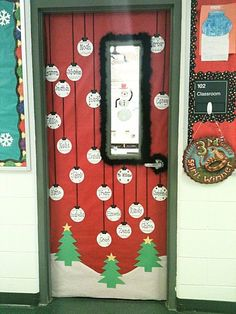 This cute winter door display features the names of the students in the class written on Christmas balls.