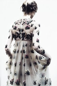 I love everything about this dress. The silhouette, the floral embellishments on the sheer fabric- perfect.