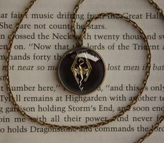 Handmade Vintage bronze style Skyrim emblem cabochon dome inspired glass cabochon dome pendant on Etsy, $12.50